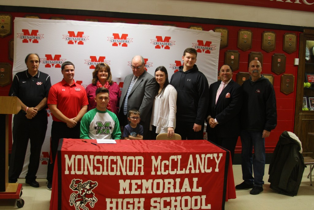 Kyle, his coaches and family at McClancy Wednesday.